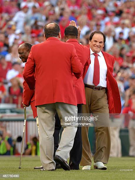Former Cincinnati Reds player Pete Rose gets a highfive from Barry Larkin during a pregame ceremony prior to the 86th MLB AllStar Game at Great...