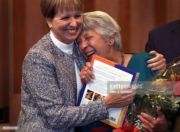 Former city council member Lisa Mills left hugs Pat McGuigan during a ceremony at her last Santa Ana City Council meeting Tuesday McGuigan the first...