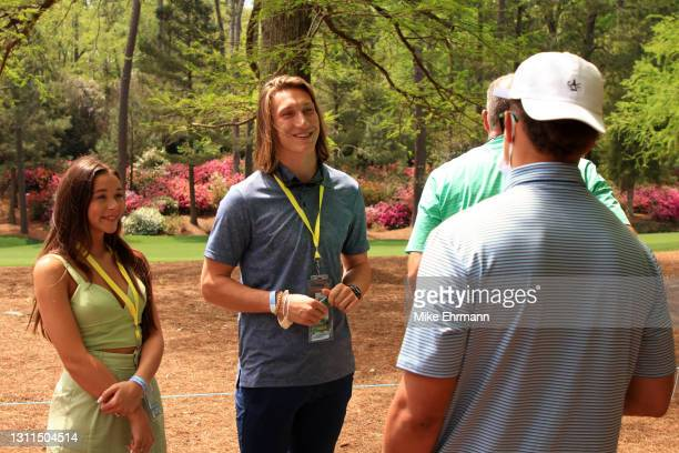 Former Clemson quarterback Trevor Lawrence and his fiancé Marissa Mowry talk to Patrick Mahomes of the Kansas City Chiefsaas they watch play on the...