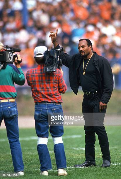 Former Cleveland Brown running back Jim Brown acknowledge the fans prior to the start of an NFL football game circa 1984 at Cleveland Municipal...