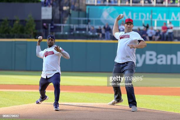 Former Cleveland Browns Andrew Hawkins and Joe Thomas throw ceremonial first pitches prior to the Major League Baseball Interleague game between the...