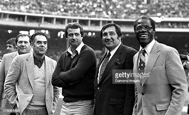 Former Cleveland Browns players Gene Hickerson Otto Graham Gary Collins Lou Groza and Bill Willis gather on the field prior to a game circa 1984 at...