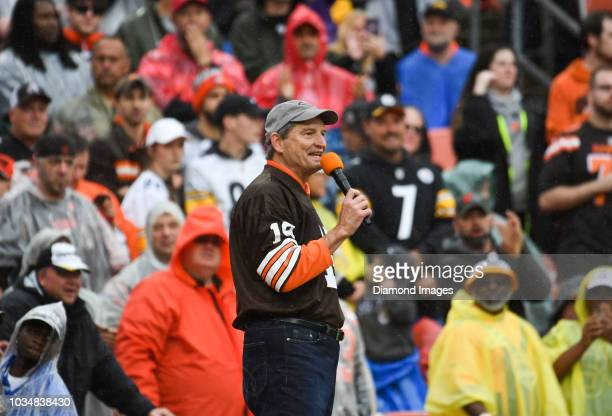 Former Cleveland Browns quarterback Bernie Kosar speaks to the crowd during a timeout in the first quarter of a game against the Pittsburgh Steelers...