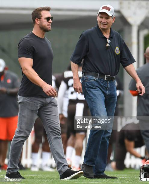 Former Cleveland Browns quarterbacks Tim Couch and Bernie Kosar walk onto the field during a training camp practice on July 30 2018 at the Cleveland...