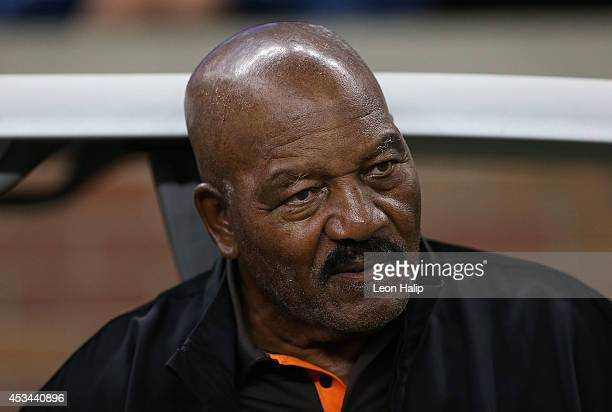 Former Cleveland Browns running back and National Football League Hall of Famer Jim Brown watches the action from the sidelines prior to the start of...