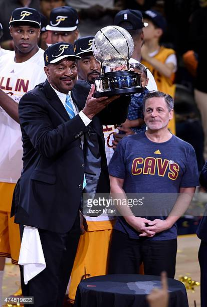 Former Cleveland Cavaliers Larry Nance and Cavaliers owner Dan Gilbert celebrate with the trophy after defeating the Atlanta Hawks during Game Four...