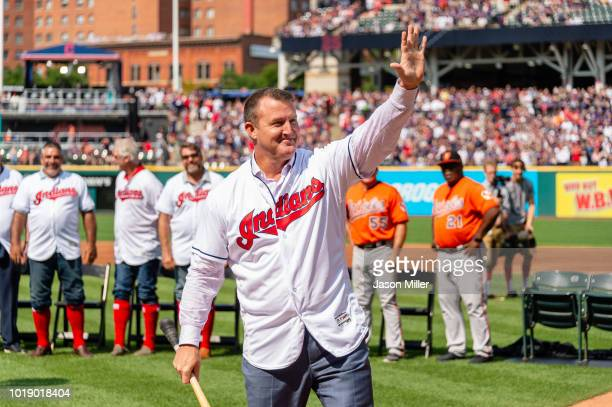 Former Cleveland Indian Jim Thome waves to the crowd during a ceremony celebrating his induction into the Hall of Fame prior to the game against the...