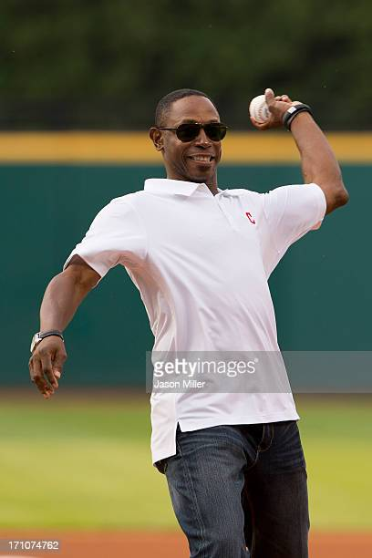 Former Cleveland Indians great Kenny Lofton throws out the ceremonial first pitch prior to the game between the Cleveland Indians and the Minnesota...
