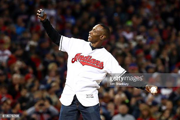 Former Cleveland Indians outfielder Kenny Lofton throws the first pitch prior to Game One of the 2016 World Series against the Chicago Cubs at...