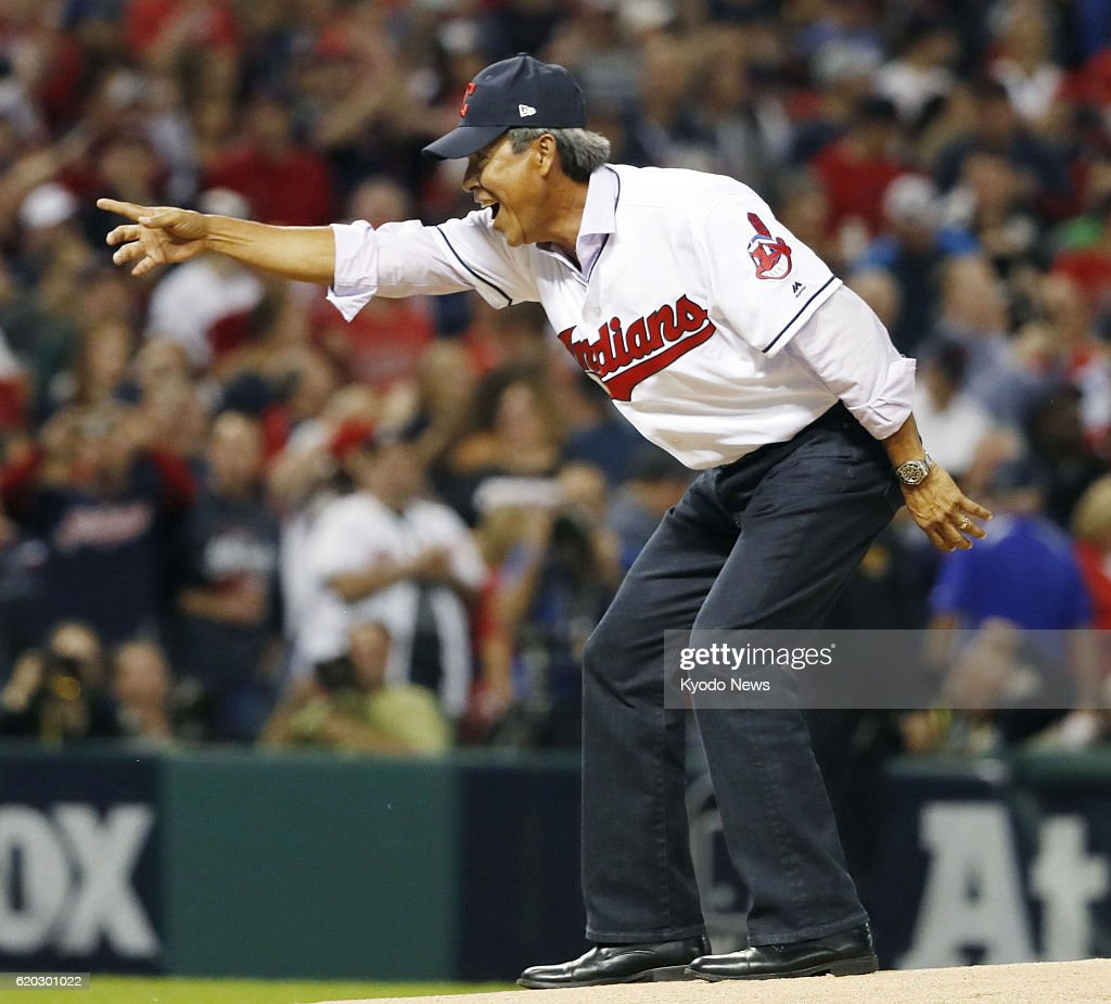 Former Cleveland Indians pitcher Dennis Martinez reacts after throwing out the ceremonial first pitch for Game 6 of the World Series between the Indians and the Chicago Cubs at Progressive Field in Cleveland, Ohio, on Nov. 1, 2016.