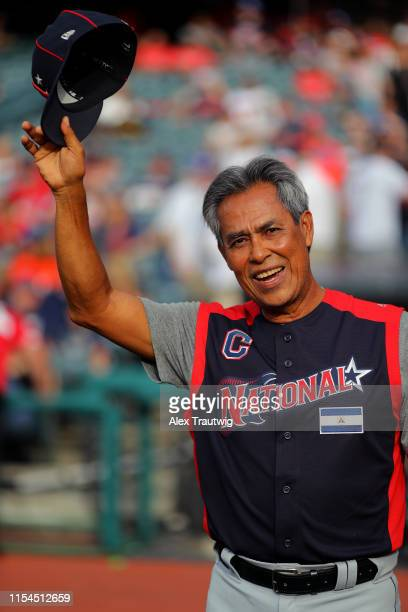 Former Cleveland Indians player Dennis Martinez acknowledges the crowd during the pre-game ceremony prior to the SiriusXM All-Star Futures Game at...