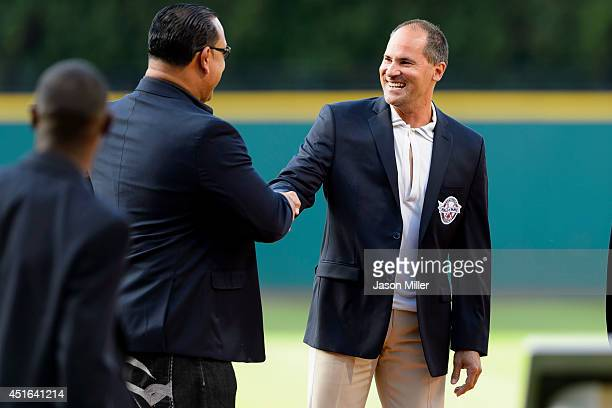 Former Cleveland Indians players and Indians Hall of Fame inductees Carlos Baerga left and Omar Vizquel right during induction ceremonies prior to...