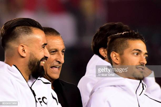 Former coach and player of River Plate Ramon Diaz laughs with Ariel Rojas and Manuel Lanzini during Fernando Cavenaghi's farewell match at Monumental...