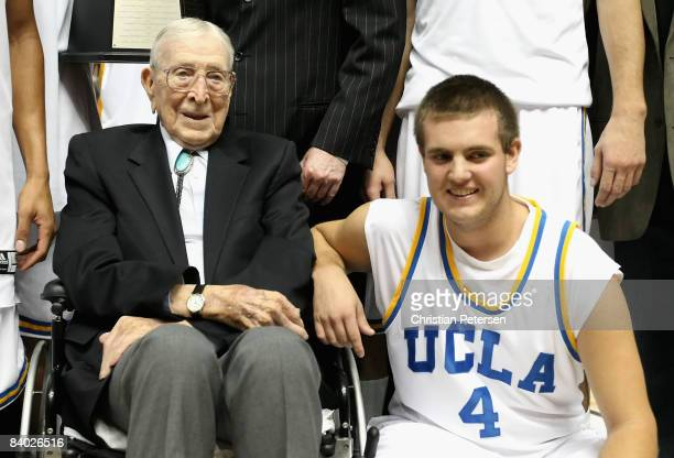 Former coach John Wooden poses with great grandson Tyler Trapani of the UCLA Bruins after the John R Wooden Classic game against the DePaul Blue...
