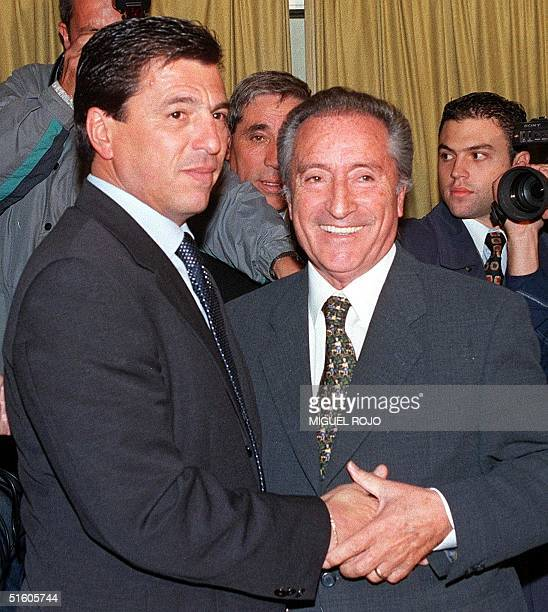 Former coach of the Argentine soccer national selection Daniel Pasarella shakes hands with Eugenio Figueredo president of the Uruguayan Futbol...