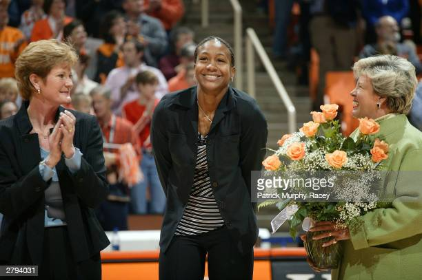 Former coach Pat Head Summit Tamika Catchings and Lady Vols athletic director Joan Cronan during a halftime ceremony retiring Catchings college...