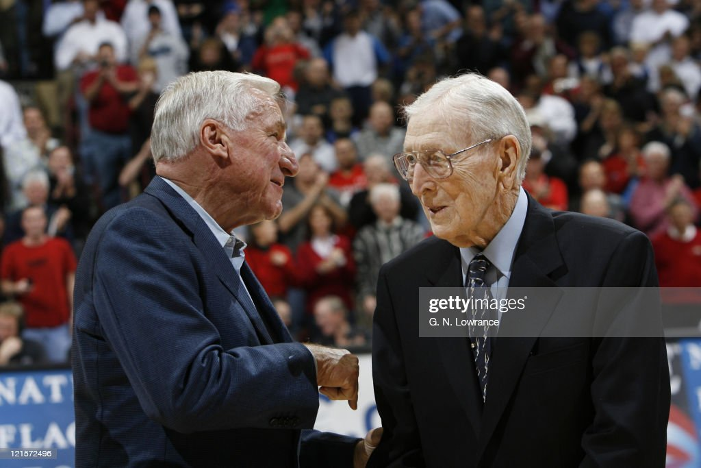 Former coaches Dean Smith and John Wooden during semi-final action between Air Force and Duke at the annual CBE Classic at Municipal Auditorium in Kansas City, Missouri on November 20, 2006. Duke won 71-56.