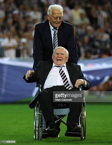 Former Collingwood legend Lou Richards is assisted out to the flag raising ceremony before the round three AFL match between the Collingwood Magpies...