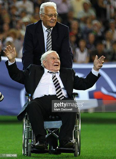 Former Collingwood legend Lou Richards is assisted out to the flag raising ceremony during the round three AFL match between the Collingwood Magpies...