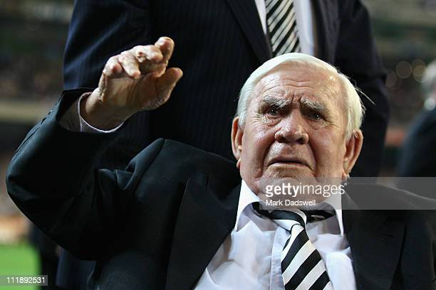 Former Collingwood legend Lou Richards waves to the crowd at the flag raising ceremony during the round three AFL match between the Collingwood...