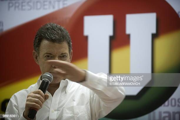 Former Colombian defence minister Juan Manuel Santos and presidential candidate for the ruling Partido de la U speaks during a meeting with...