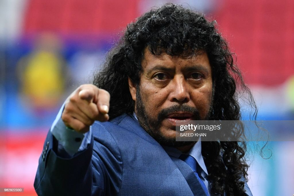 Former Colombian football legend Rene Higuita gestures before the Russia 2018 World Cup Group H football match between Poland and Colombia at the Kazan Arena in Kazan on June 24, 2018. (Photo by SAEED KHAN / AFP) / RESTRICTED