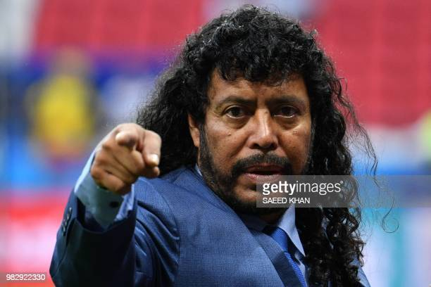 Former Colombian football legend Rene Higuita gestures before the Russia 2018 World Cup Group H football match between Poland and Colombia at the...