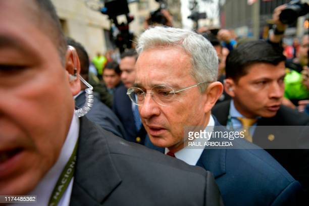 Former Colombian President and Senator Alvaro Uribe arrives to the Palace of Justice for a hearing before the Supreme Court of Justice in a case over...