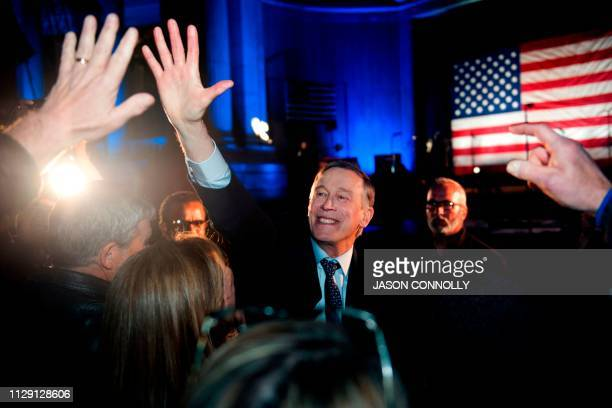 Former Colorado Governor John Hickenlooper greets supporters after his campaign kickoff rally for the 2020 US presidential race at Civic Center Park...