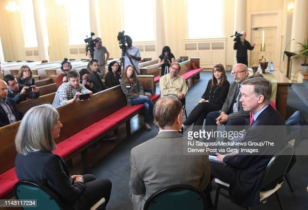 Former Colorado Governor John Hickenlooper who is running for president talks with the parents of Claire Davis who was killed at Arapahoe High School...