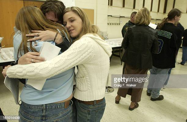 Former Columbine High School students Heather Pearce, Erin Walton and Sarah Deboer embrace, the group was viewing evidence in the auditorium at the...