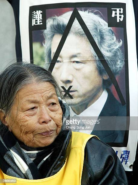 A former 'comfort woman' who served as sex slave for Japanese troops during World War II attends an antiJapanese rally in front of the Japanese...
