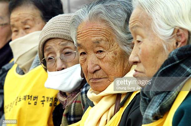 Former 'comfort women' who served as sex slave for Japanese troops during World War II shout anti Japan slogans during a rally in front of the...