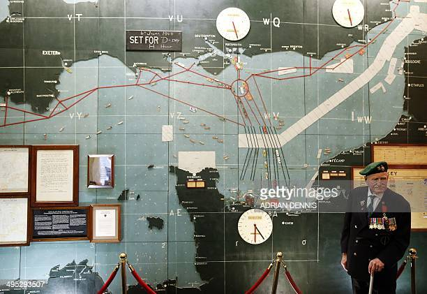 Former Commando Pat Churchill stands in the map room where the D-Day landing beaches are marked at Southwick House near Portsmouth on June 2, 2014....