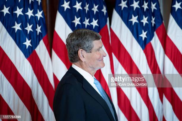 Former Congressman and Olympic runner Jim Ryun listens before being awarded the Presidential Medial of Freedom by US President Donald Trump during a...