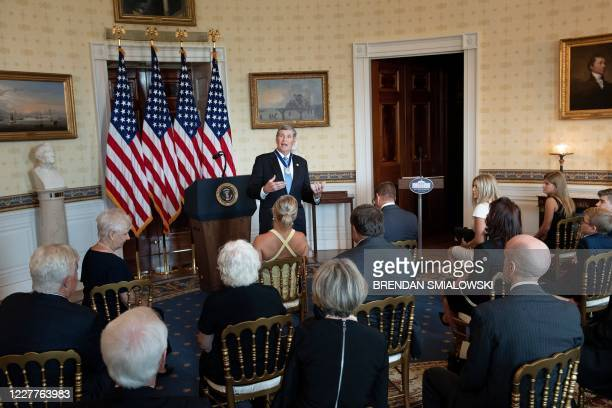 Former congressman and Olympic runner Jim Ryun speaks to loved ones after being awarded the Presidential Medial of Freedom by US President Donald...