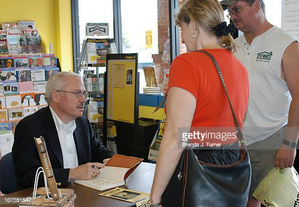 Former Congressman Bob Barr signs his new book The Meaning Of Is at Chapter 11 Bookstore in Marietta Georgia