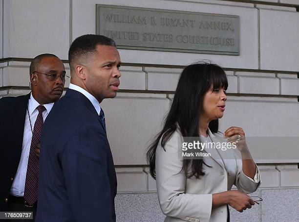 Former Congressman Jesse Jackson Jr and his wife Sandi Jackson leave the federal court house after being sentenced to prison August 14 2013 in...