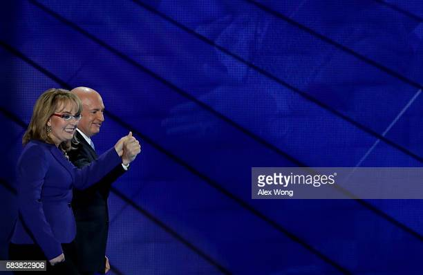 Former Congresswoman Gabby Giffords and her husband retired NASA Astronaut and Navy Captain Mark Kelly hold hands as they walk off stage after...