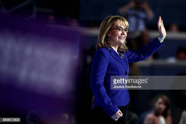 Former Congresswoman Gabby Giffords waves to the crowd on the third day of the Democratic National Convention at the Wells Fargo Center, July 27,...