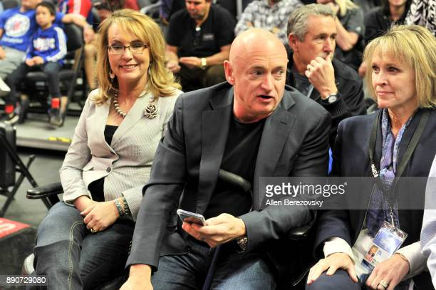 Former congresswoman Gabrielle Giffords and astronaut Mark Kelly attend a basketball game between the Los Angeles Clippers and the Toronto Raptors at...