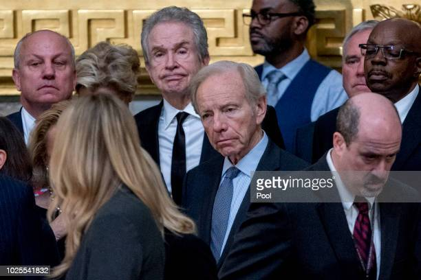 Former Connecticut Sen Joe Lieberman center and actor Warren Beatty center left watches a ceremony for Sen John McCain RAriz as he lies in state in...