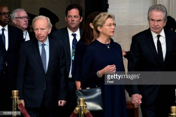 Former Connecticut Sen Joe Lieberman left and actors Warren Beatty right and his wife Annette Bening second from right arrive in the Rotunda before...