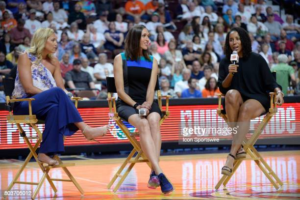 Former Connecticut Sun Players Katie Douglas Rebecca Lobo Nykesha Sales answer questions during the halftime as the Connecticut Sun host the Seattle...