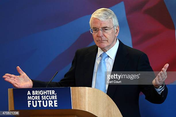 Former Conservative British Prime Minister John Major gestures during a speech on April 21, 2015 in Solihull, England. Major joined the election...