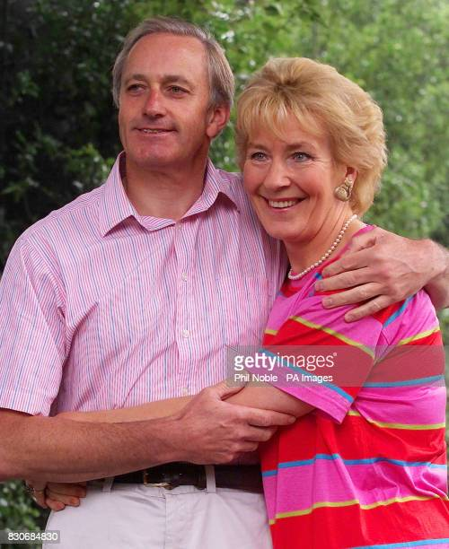 Former Conservative Minister Neil Hamilton and his wife Christine posing for photographers outside their home in Alderley Edge Cheshire The couple...