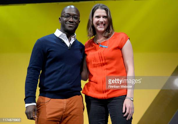 Former Conservative MP Sam Gyimah joins the Liberal Democrat leader Jo Swinson on stage at the Liberal Democrat Party Conference at the Bournemouth...