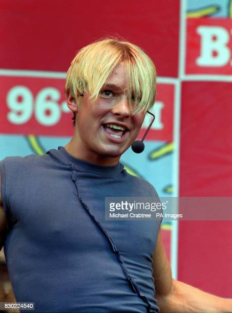 Former Coronation Street actor Adam Rickitt sings to the crowd at the Cash For Kids Concert at Birmingham's Cannon Hill Park