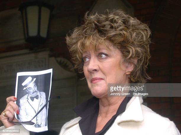 Former Coronation Street actress Amanda Barrie holds a copy of the order of service at the funeral of her long estranged husband Robin Hunter at...
