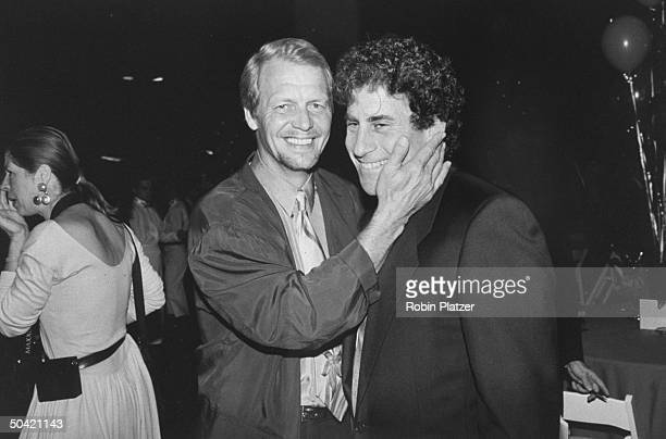 Former costars of TV's Starsky and Hutch actors David Soul and Paul Michael Glaser greeting each other affectionately at a benefit screening of the...